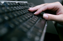 Stock image of an individual typing on a keyboard